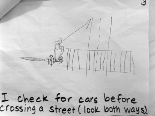 I check for cars before crossing a street.